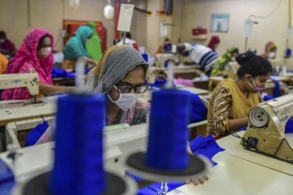 Workers in a factory in Bangladesh wear face masks because of Covid-19
