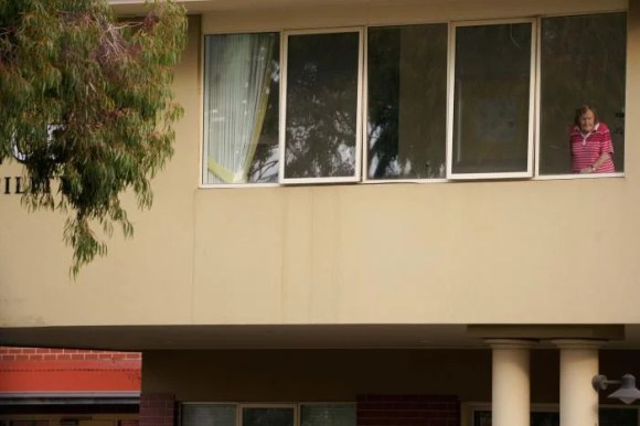 A resident looks out from the window of the Florence Aged Care Facility amid the second wave of the coronavirus disease (COVID-19) in Melbourne, Australia August 17, 2020.