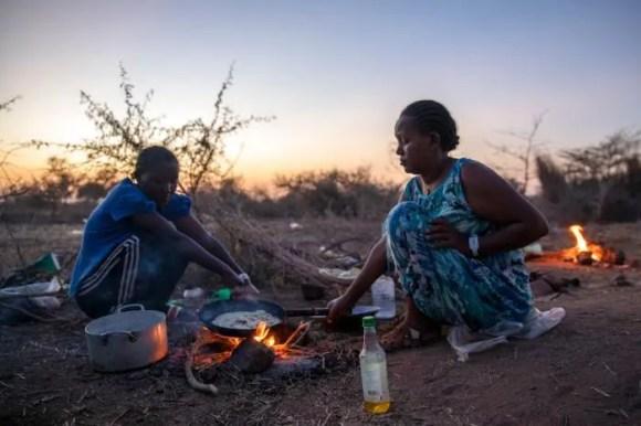 Tigrayan women who fled the conflict in Ethiopia's Tigray region, cook at Umm Rakouba refugee camp in Qadarif, eastern Sudan, November 25, 2020.