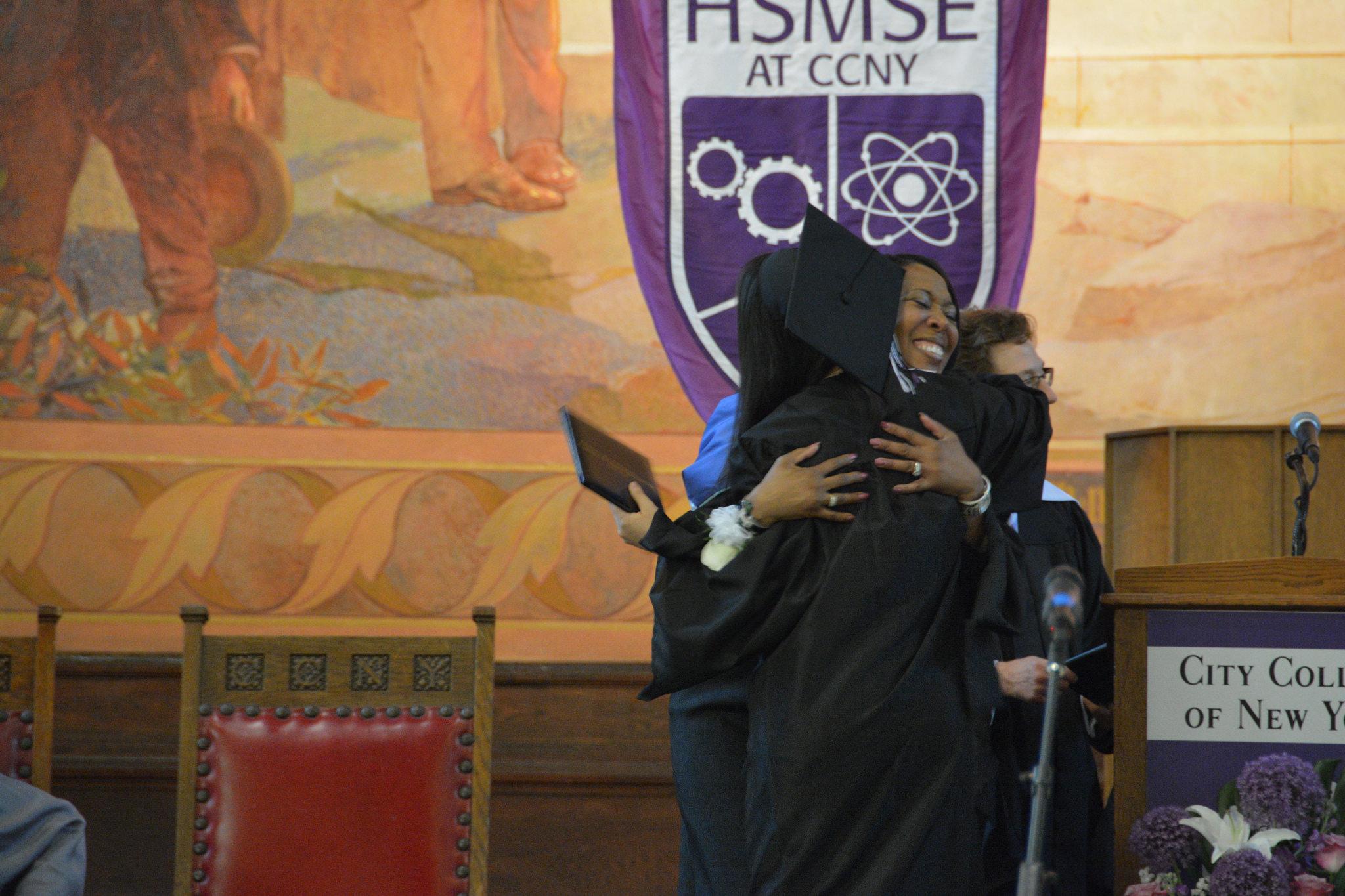 graduation hugs