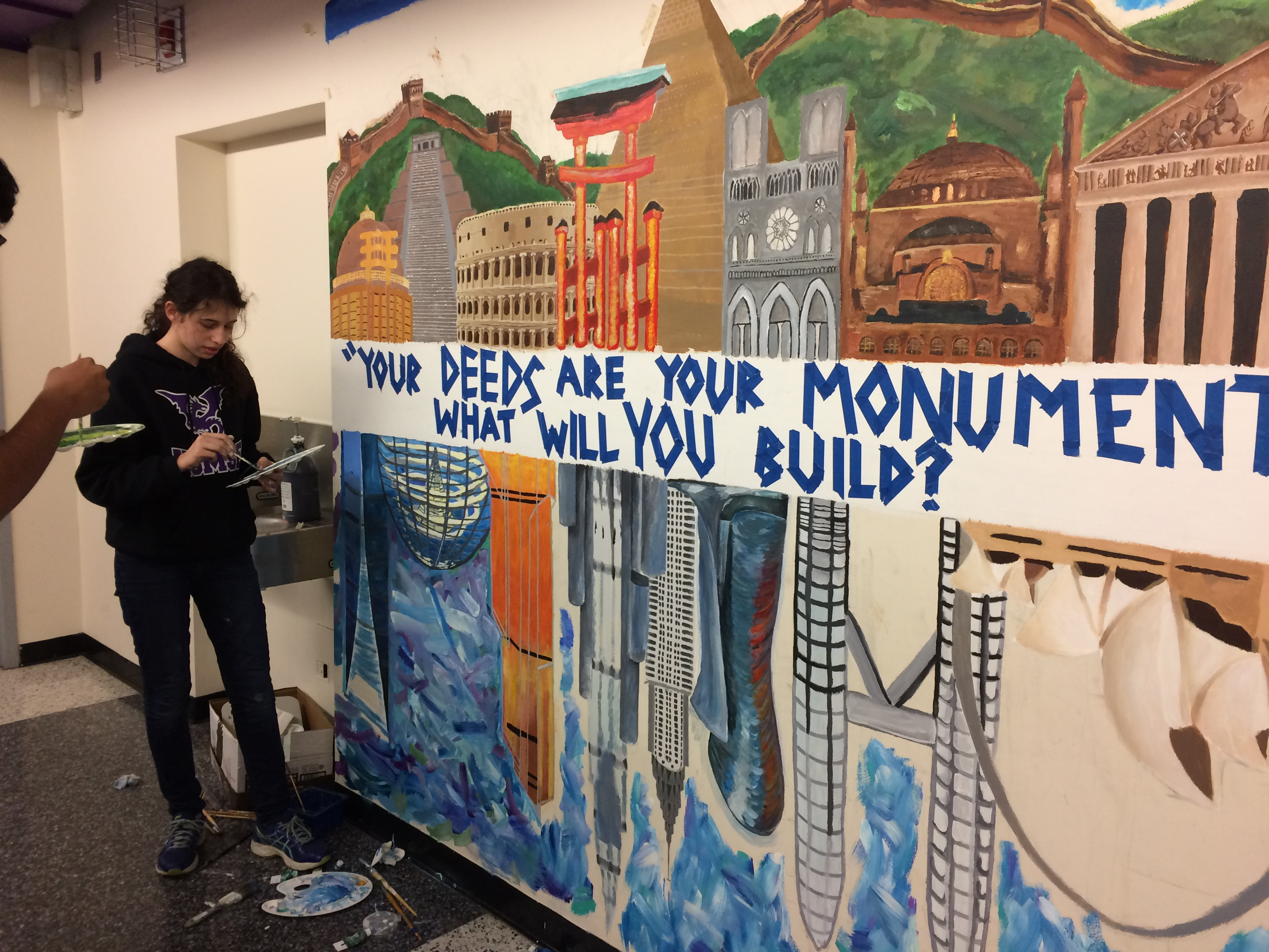 Students painting a mural outside the World History classrooms.