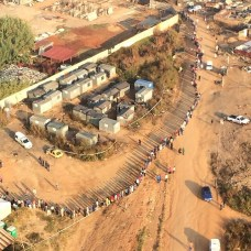 Great aerial view of residents in Alexandra waiting to vote. #voteSA Photo by @ewnupdates
