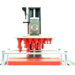 The G Printer is a crowd funded resin 3D printer that does a few things differently