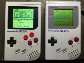 (Left) The Game Boy Zero and (Right) the original unit. Notice the extra buttons and better screen.