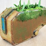 Bastion from Overwatch 3D printed as an overgrown plant pot