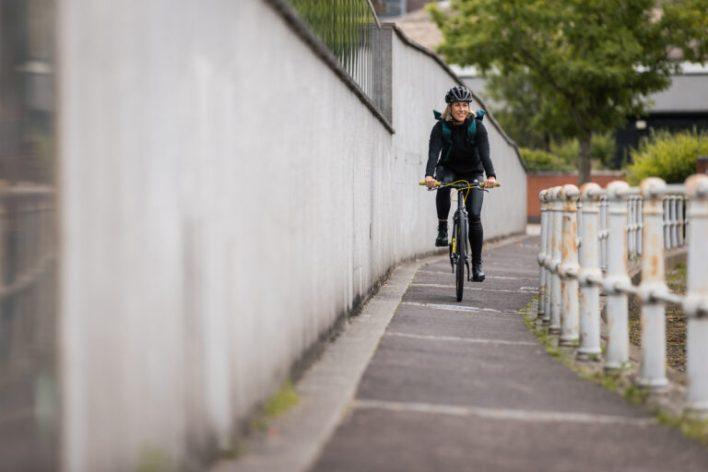 A cyclist enjoying a ride on a commuter-style bike