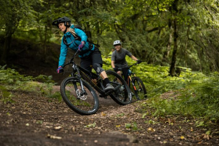Two mountain bikers riding trails