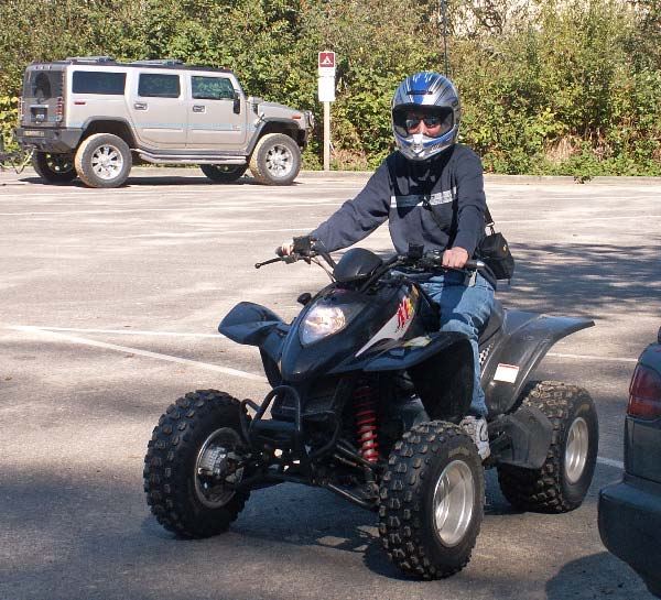 Picture of Aunt Marta riding a quad in the Oregon dunes