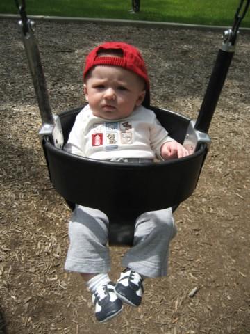 Owen swinging at the park