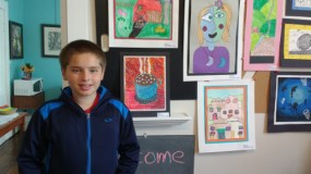 Seton student with his artwork, May 2016