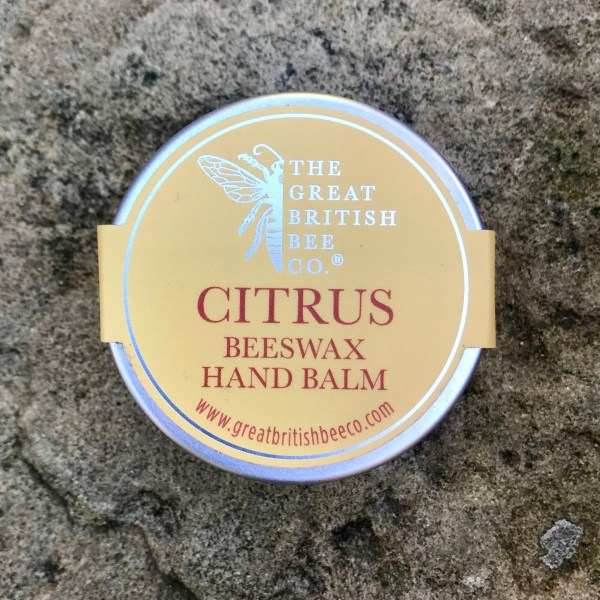 tub of hand balm with the word citrus and a bee on the lid