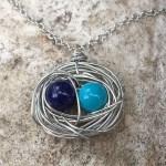 blue pair bird nest necklace