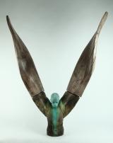 "<h5>Helicoide IV</h5><p>Bronze and wood, 50 x 45 x 12¼"" (127 x 114 x 31cm)</p>"