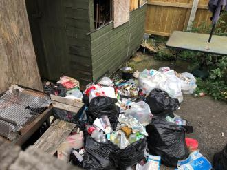 Resident fined for not clearing rubbish from her garden