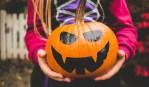 A girl with a pumpkin
