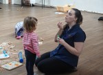 A mum blows bubbles for a child