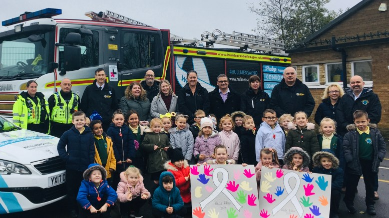 Pupils at Greenway Academy on Pupils at Green Way Academy were visited by a white ribbon-wrapped fire engine and police car to mark White Ribbon Day.White Ribbon Day.