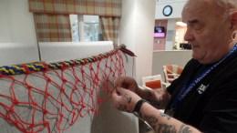 Volunteer Thomas Nielson with the fishing net display.
