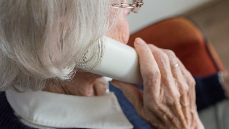 An elderly woman on the phone.