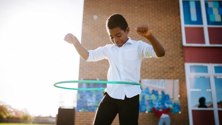 A boy with a hula hoop.