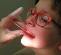 a boy biting