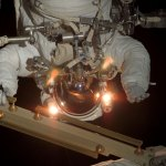 STS-117 mission specialist Patrick Forrester hovering outside the International Space Station