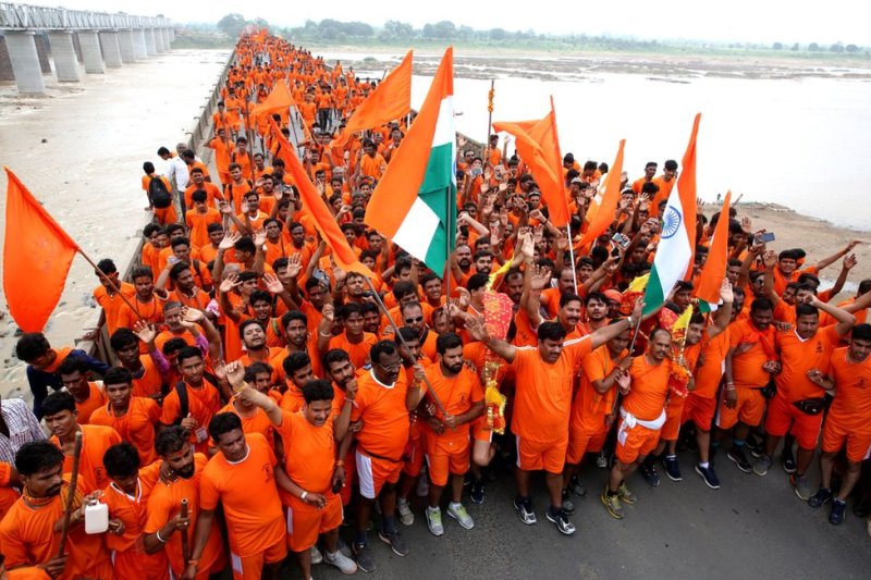 Kanwariyas gather after collecting water from the river Narmada during their annual pilgrimage on 4 August 2018.