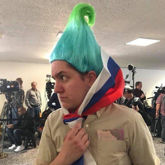 Ian Madrigal as a Russian troll