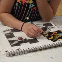 teen student drawing in class