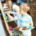 Young Child Painting in a Summer Class in MA