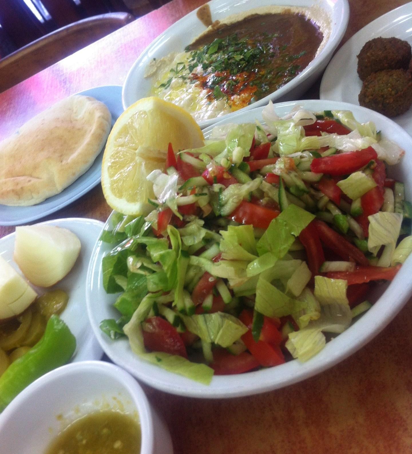 Falafel, salad, pitta, raw onion, chilli sauce and fresh tomato.
