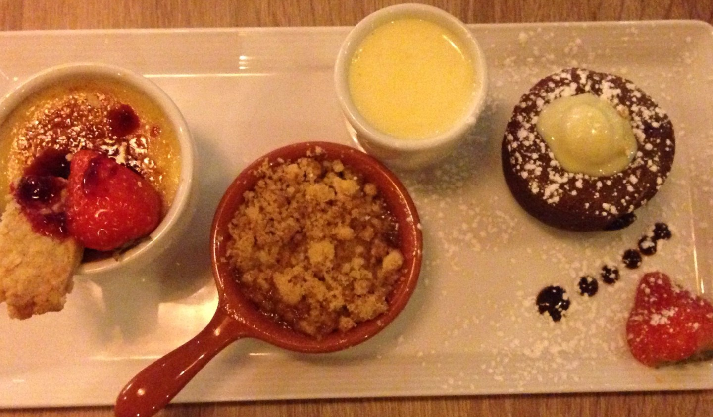Trio of desserts - creme brulee, apple crumble and chocolate brownie. Stuffed!