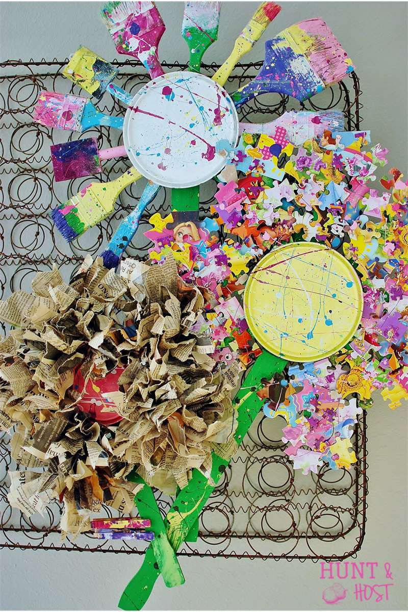 paint brushes, newspaper and puzzle pieces flowers