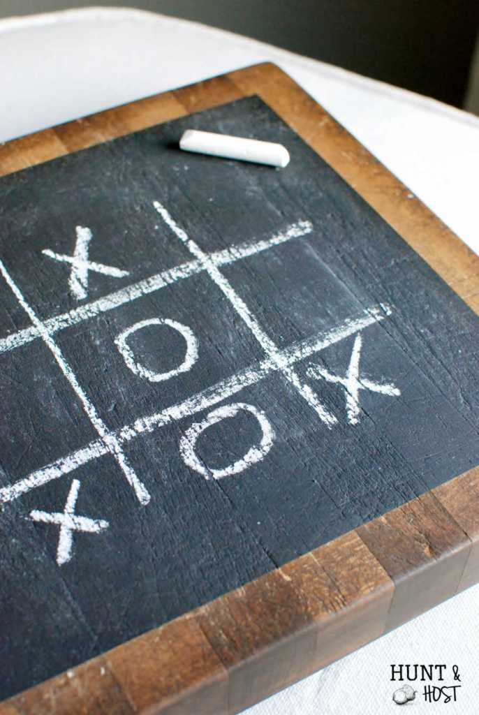 This thrifted old butcher block gets a chalkboard makeover to display a fun game of tic tac toe for the family! www.huntandhost.net