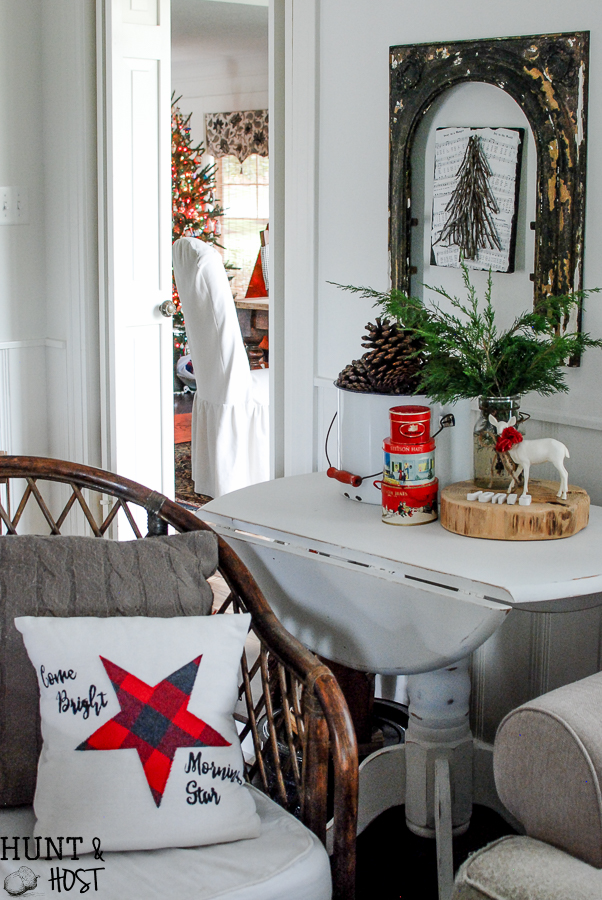 My Christmas farmhouse homes tour, featuring a sled centerpiece, vintage hat boxes, fresh cut greenery and pops of red and green.
