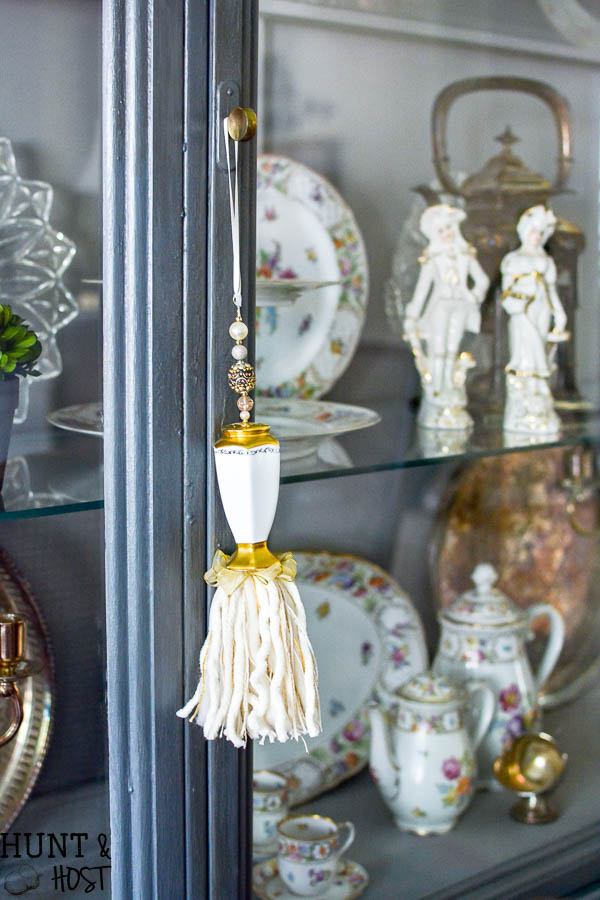 French Cajun dining room décor ideas inspired by Empress Dresden Flowers China pattern. Dining room ideas to including a gray painted china hutch and pink rug.
