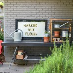 How to make a sleek potting table. This potting bench, painted black is a departure from the chippy white farmhouse look. Plus three must see ideas for professional and fast painted outdoor furniture.