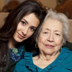 caregiver hugging elderly patient