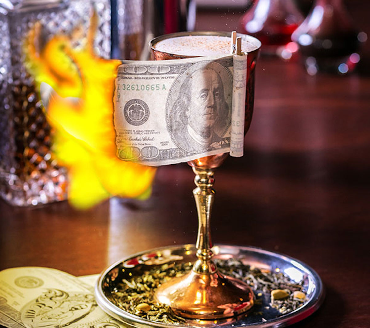 Cocktail with American currency lit