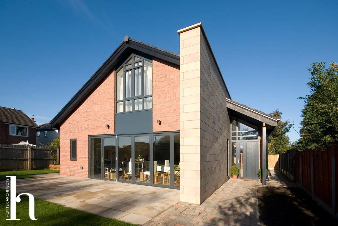 Double height entrance by Chartered Architects in Altrincham