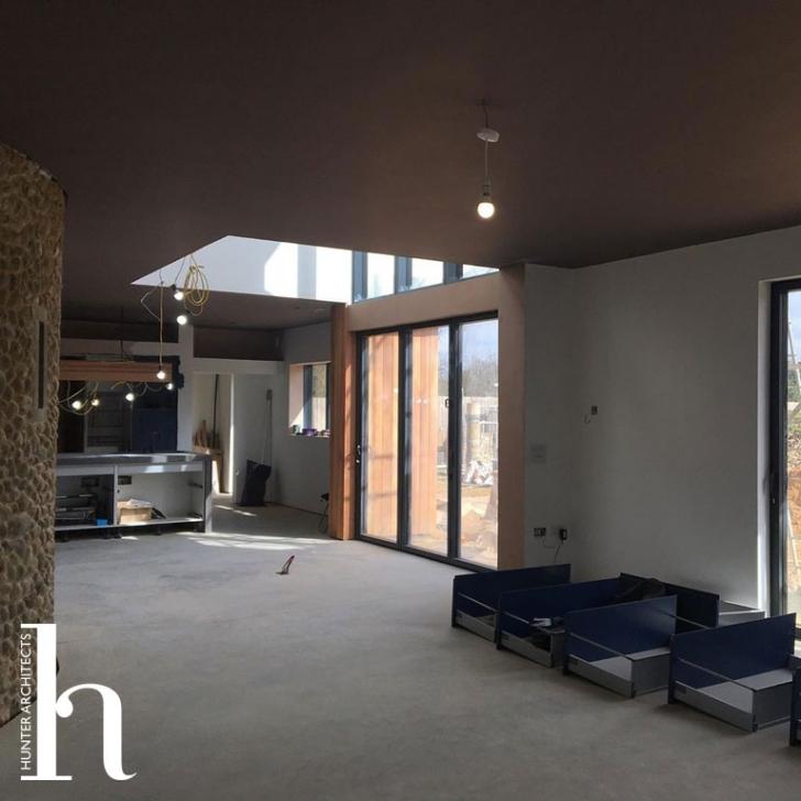 Double height space overlooking garden with walkway above