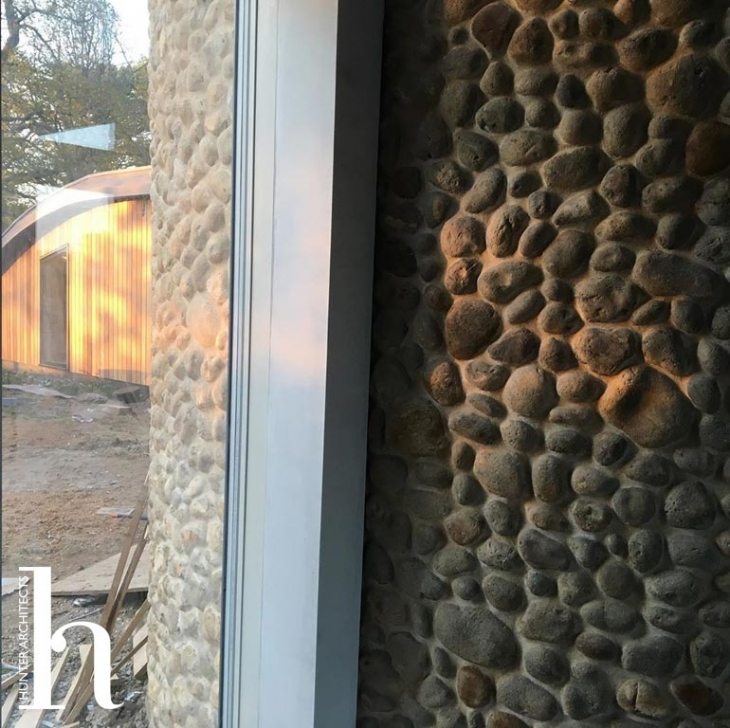 Natural flint wall extending inside and outside