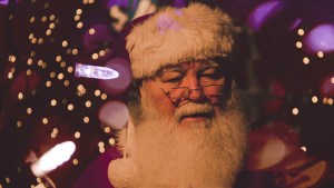 santa portrait with christmas lights in background