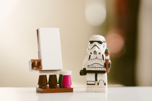 LEGO stormtrooper with lego paintbursh and easle
