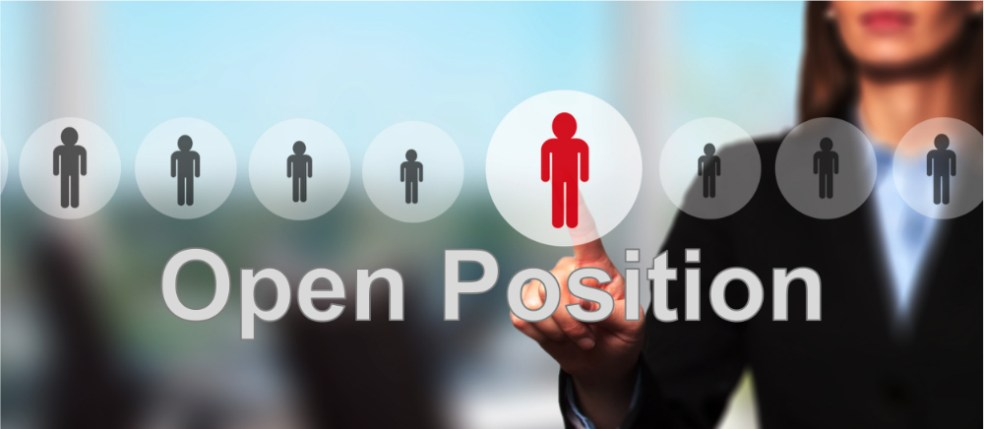 Open position: woman in business attire in office
