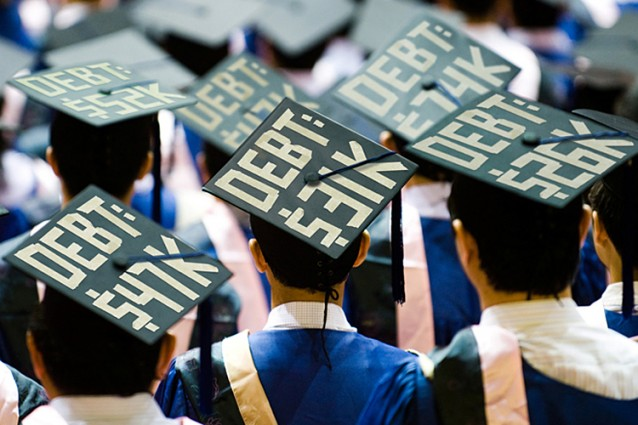 Students displaying amount of student loan debt owed on graduation caps