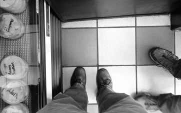 view of tile floor with feet