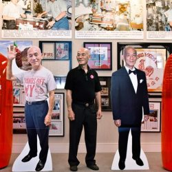 David Tran CEO of Huy Fong Foods with cutouts of himself and Sriracha bottles full