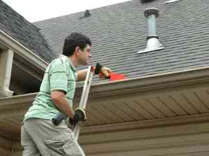 dad cleaning gutters
