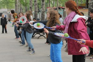The girls try their hand at paddleball dancing.